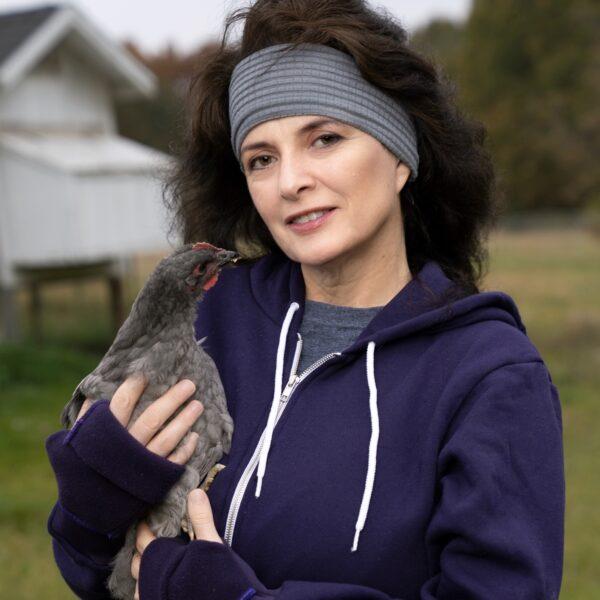 Turtle Gloves Mitten Hoodie purple on model holding chicken