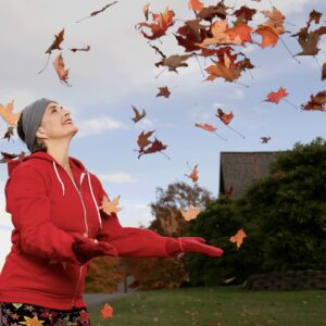 Turtle Gloves Mitten Hoodie red on model tossing fall leaves