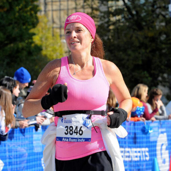 Turtle Gloves Running Lifestyle Female Athlete Running Race with Lightweight Turtle Flip Mittens dressed in pink and black